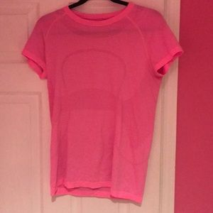 Bright pink lulu lemon t-shirt